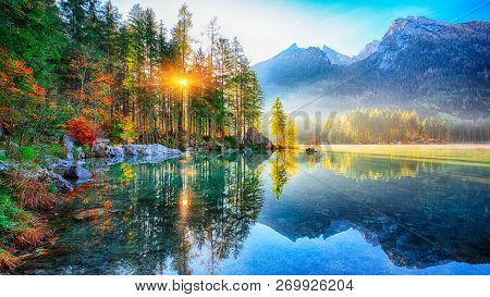 Fantastic Autumn Sunrise Of Hintersee Lake. Beautiful Scene Of Trees Near Turquoise Water Of Hinters