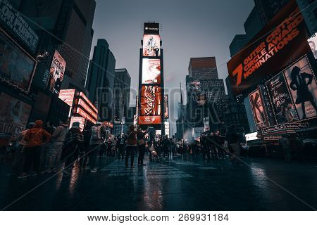 New York, Usa - Apr 30, 2016: Times Square In The Rainy Evening. Brightly Adorned With Billboards An