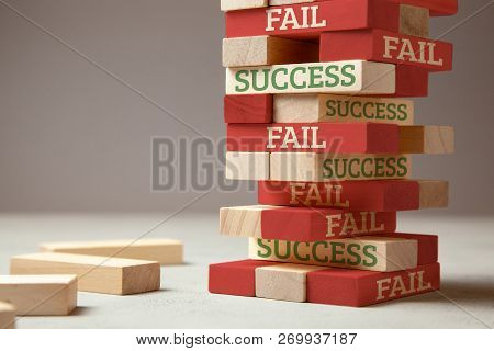 Success And Fail. Wooden Tower Of Blocks. Failure Is Like A New Step For Success. Failure Gives Expe
