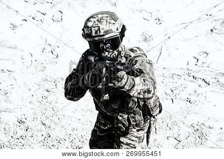 Airsoft War Game Player Shooting With Gun Replica