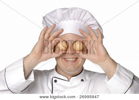 Cook holding two eggs. Chef holding two eggs.