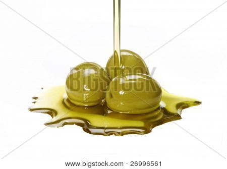 Olive oil pouring out. Pouring olive oil. Olive oil.