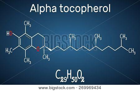 Alpha Tocopherol ( Vitamin E) Molecule. Structural Chemical Formula And Molecule Model On The Dark B