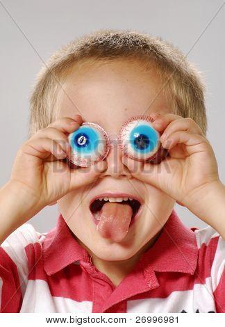 Little boy gesturing with false eyes,funny little Boy gesturing.