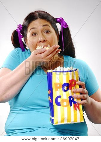 Fat young woman eating popcorn,young woman eating popcorn,