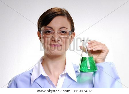 Female scientist holding a chemical liquid glass.