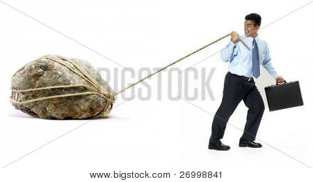 Businessman pulling a big rock on white background.
