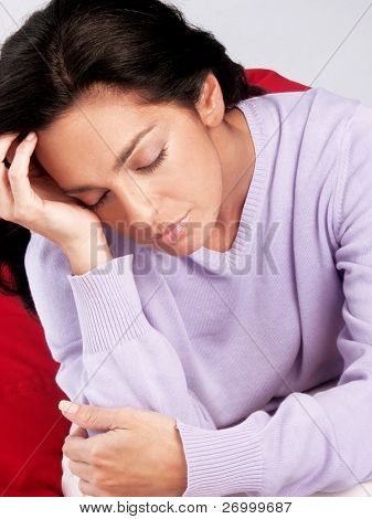 Tired latin woman at home. Portrait from a depressed hispanic woman.