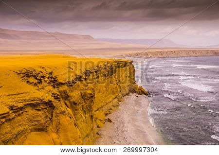 Yellow Cliffs At Paracas National Reserve In Peru: The Coastal Desert Landscape Of Paracas National