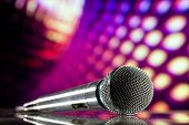 microphone against purple disco background poster