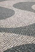 "Typical Portuguese black and white mosaic cobble stone paving ""calcada"" - Lisbon Portugal poster"