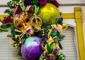 Colorful mask and decorations for Mardi Gras in New Orleans poster