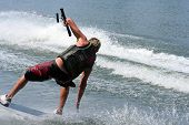 Teenage boy showing skill and balance on the wakeskate. poster