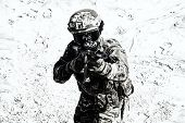Airsoft war game player shooting with gun replica poster