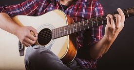 Guy Playing An Acoustic Guitar At A Recording Studio.