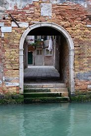 Venice, Italy Street View With Old Brick Wall And Entrance To Courtyard