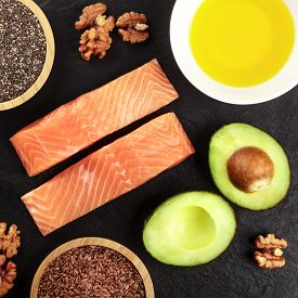 Healthy Omega 3 Diet Food. Salmon, Avocado, Nuts, Chia Seeds And Flaxseeds, Shot From Above On A Dar