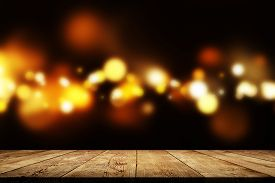 Golden Bokeh Behind Wooden Table As Background