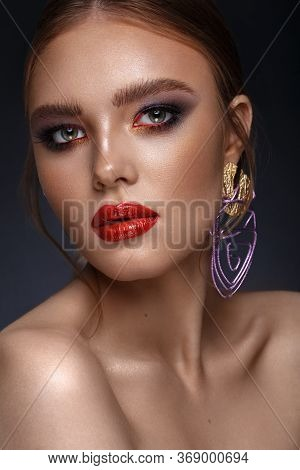 Beautiful Girl With Bright Fashionable Make-up And Unusual Purple Accessories. Beauty Face.