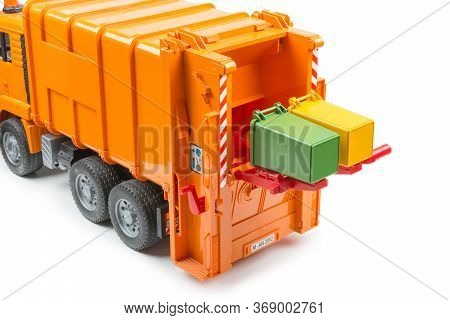 Orange Toy Garbage Truck With Two Garbage Containers, Isolated Object, White Background, Garbage Tru