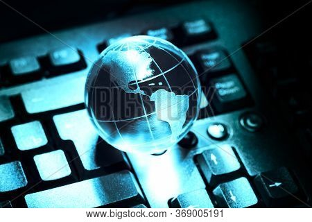 World Transparent Globe Earth On Computer Keyboard. Global Communications Business Concept. Blue Ton