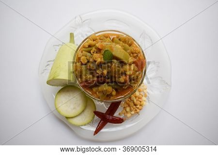 Selective Focus Of Bottlegourd Or Kaddu Louki Dal Sabji Served Hot In Transparent Bowl Plate. Gujara