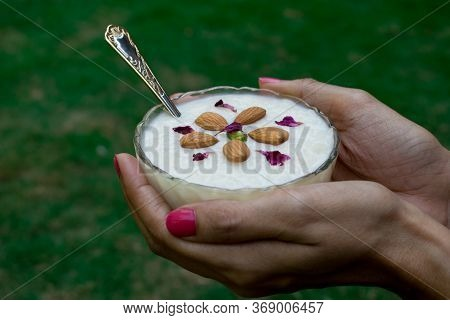 Female Holding Dessert Kheer/khir (rice Pudding)in Palms Made Of Milk, Rice, Sugar And Dry Fruits. P