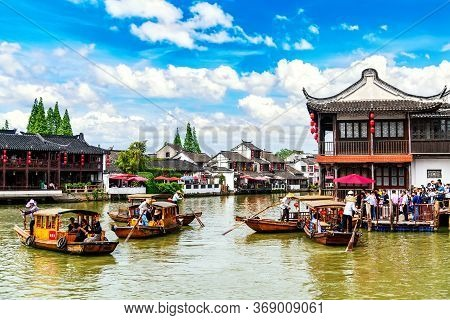 Shanghai, China - May, 2019: China Traditional Tourist Boats On Canals Of Shanghai Zhujiajiao Old To