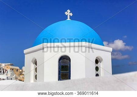 Close-up Of The Round Dome Of The Church With A Blue Cross, White Stone Walls Against The Blue Sky I