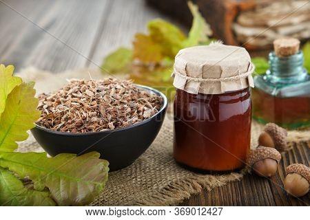 Healthy Oak Bark In Black Ceramic Bowl, Jar Of Herbal Salve Or Balm, Infusion Or Tincture Bottle, Ol
