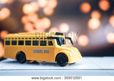 Yellow School Mini Bus Kids Toy, Student Transport For Children Transports Service On Blurred Agains