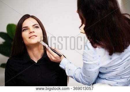 A Professional Make-up Artist Makes An Evening Make-up For A Young Woman