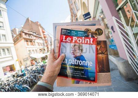 Paris, France - May 30, 2020: Man Hand Holding Le Point Magazine Newspaper Featuring Angela Merkel C