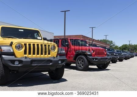 Indianapolis - Circa May 2020: Jeep Wrangler Display At A Chrysler Jeep Dealership. The Subsidiaries