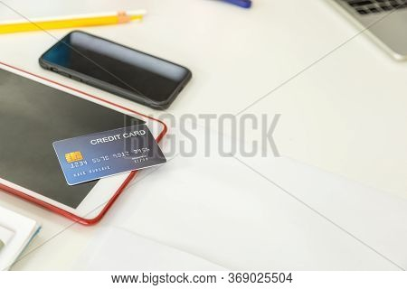 E-commerce And Mobile Online Shopping Concept. Close Up Of Mockup Fake Credit Card On Computer Table