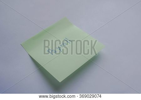 Business Concept Of Employee Monthly Payroll Isolated Handwritten On The Green Sticky Postit Note