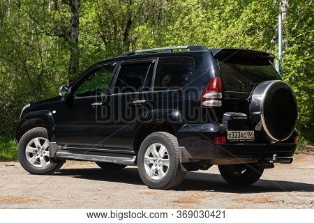 Novosibirsk/ Russia - May 12, 2020, Black  Toyota Land Cruiser,  Front View.  New Expensive Jeep Mad