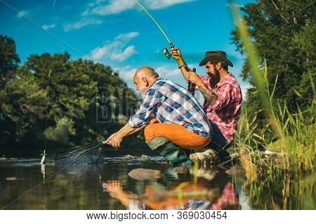 Hobby For Soul. Fly Fishing Hobby Of Men In Checkered Shirt. Fishing Requires To Be Mindful And Full