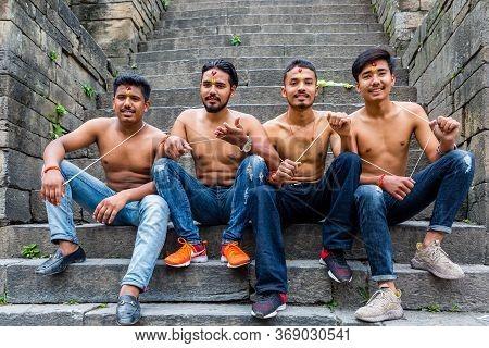 Kathmandu,nepal - August 14,2019: Hindu Brahmins People Receiving Sacred Thread Rakshya Bandhan Duri
