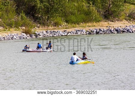 Calgary, Canada - May 30, 2020: Calgarians Paddle Their Inflatable Drift Boats As They Float Along T