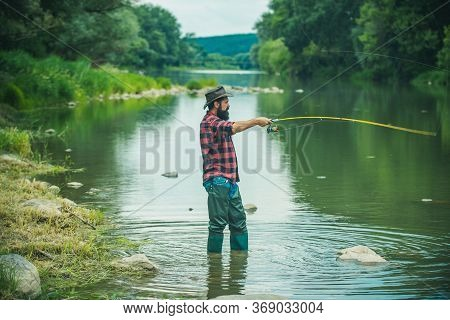 Elegant Bearded Brutal Hipster Fishing. Young Man Fishing. Summer Weekends Or Vacation. Perfect Week