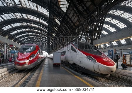 Milan, Italy - October 2019: High-speed Trains Approaching Platforms At Milano Centrale, The Main Ra