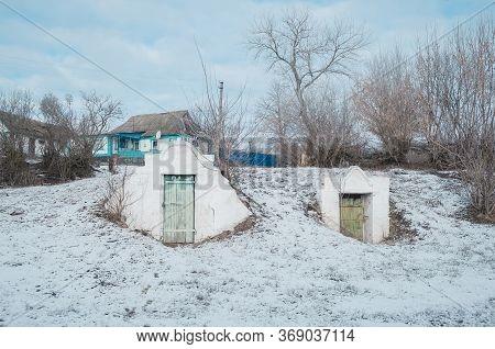 Door To The Basement Cellars Near Of Rural Buildings.