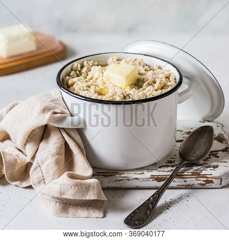 Old Fashioned Rolled Oat Porridge With Melting Butter In A Sauce Pan, Square