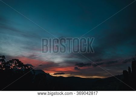 Sunset Sky With Beautiful Pink Clouds Rolling Over The Hills Of Tasmania, Australia