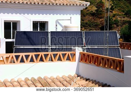 Solar Panels On A Townhouse Roof In The Village Centre, Benahavis, Costa Del Sol, Malaga Province, A