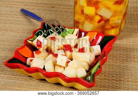Tapas, Machego Cheese Cubed With Chillies In Olive Oil, Mijas Costa, Costa Del Sol, Malaga Province,