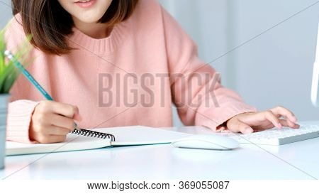 Study Online Class, Woman Hand Writing On Notebook While Tying Computer Keyboard, Adult Female Stude