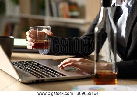 Close Up Of Entrepreneur Woman Hands Drinking Alcohol Working On Laptop Sitting On A Desk At Homeoff