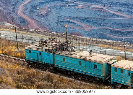 Train At The Iron Ore Opencast Mine Is Going For Loading Iron Ore Into Goods Wagon